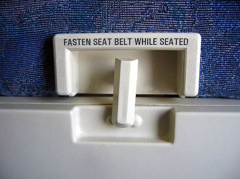 Please return your tray tables to their full, upright position